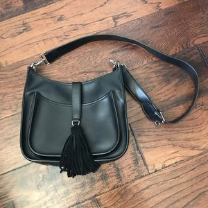 EUC black crossbody purse with tassel closure